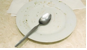 spoon on plate to show dirty dish